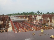 Install soffit slab formwork for level 1 podium in progress